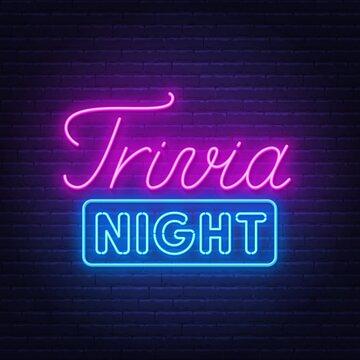 Trivia night neon sign on a brick wall .