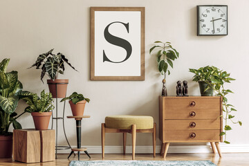 Vintage interior design of living room with stylish retro furnitures, a lot of plants, commode,...