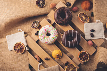 Donuts on wooden and linen background