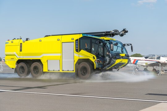 Yellow fire truck on the airport runway
