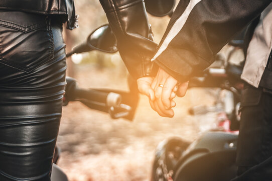 Hands of couple bikers. Happy Valentine's Day.