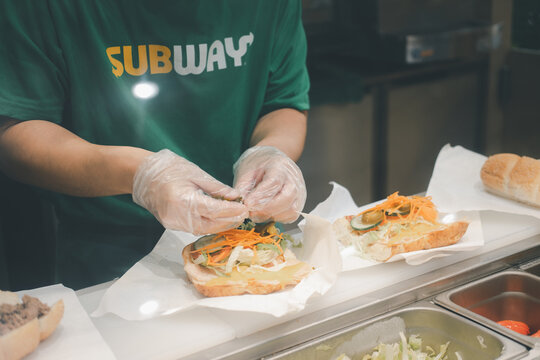 Bangkok, Thailand - January 5, 2021 : Staff is cooking sandwich at Subway restaurant