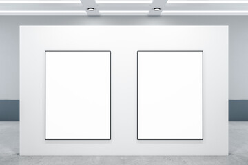 Minimalistic gallery interior with two blank posters on wall