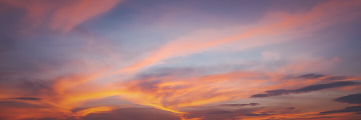 Bright beautiful sunset sky with clouds abstract natural background and texture
