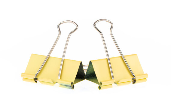 Yellow binder clips isolated on white background