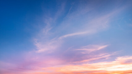 Fototapeta Beautiful colorful bright sunset sky with orange clouds. Nature sky background.