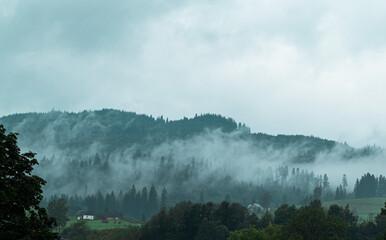 Fog in the mountains, wooded mountain peaks. Soft focus. Ukrainian mountain village
