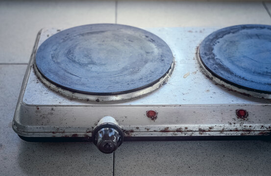 Old electric cooking stove in poor condition with rust and dirt