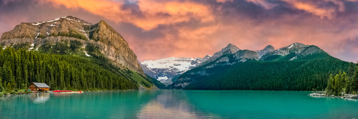 Sunset at iconic and stunning Lake Louise in Banff, Jasper National Park, Alberta, Canada. Amazing, natural sight to see for tourists, tourism and summer roadtrips.