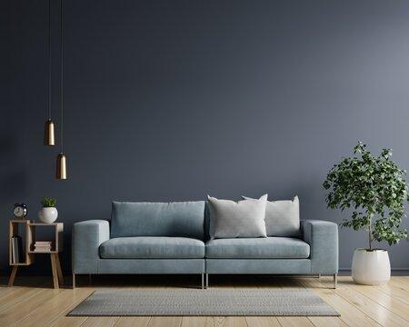 The interior has a sofa on empty dark wall background.