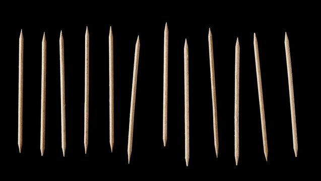 Wooden toothpick set and collection isolated on black background
