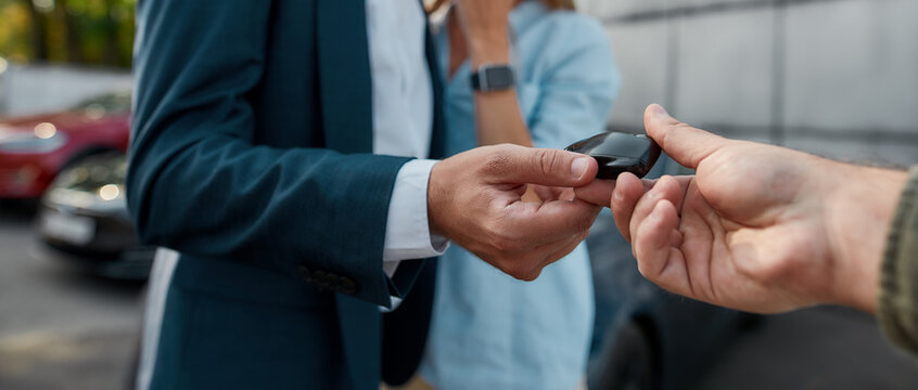Car keys given to businessman by sales manager
