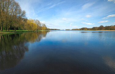 The Nesvizh park. Beautiful and clean lake against the blue sky.