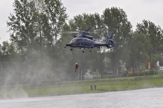 Helicopter EC155 during rescue training operation with rope
