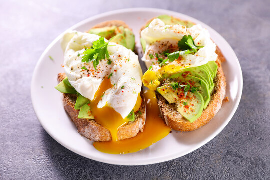 bread toast with poached egg and avocado