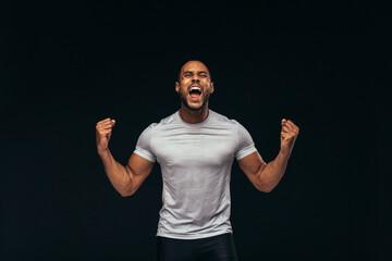 Muscular athlete shouting in joy