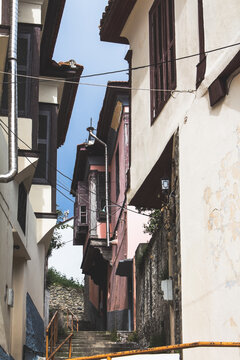 Old houses in narrow streets of Kavala, Greece