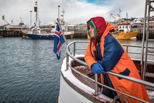 Professional fisherman in winter Iceland port