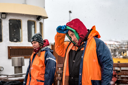 tired nordic fishermen under snowing