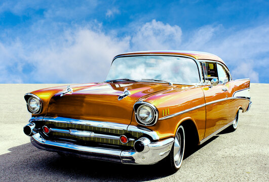 Side view of a classic american car from the fifties. The car is in excellent condition given the glossy paint.