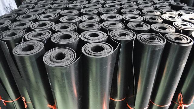 warehouse rolls of rubber. black rolls.