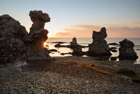 Picturesque limestone cliffs, so-called Raukar, on the east coast of the Swedish island of Gotland near Folhammar, north of Ljugarn