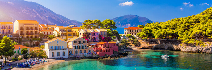 Assos village in Kefalonia, Greece. Turquoise colored bay in Mediterranean sea with beautiful...