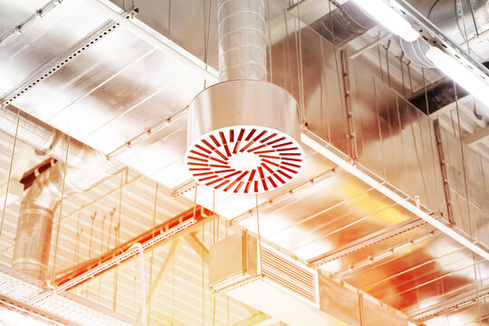 Supply and exhaust ventilation system on ceiling of commercial room or warehouse