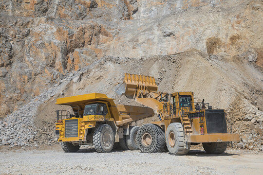 loader loading mining truck at open pit
