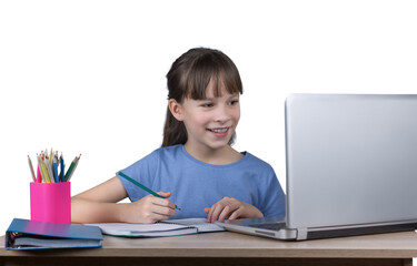 Distance learning online education. A happy girl lookes at laptop and does school homework by internet