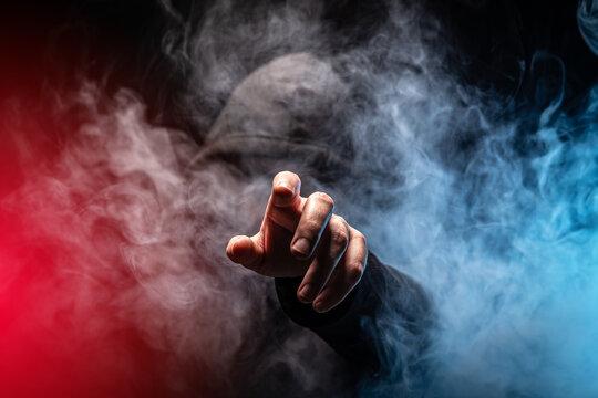 Hacker in a smoke-filled background