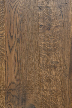 Hickory hardwood stained floor boards with wood grain