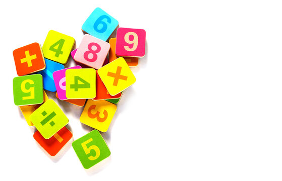 Directly Above Shot Of Multi Colored Number Blocks On White Background
