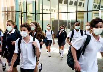 High school students wearing masks on their way home - fototapety na wymiar