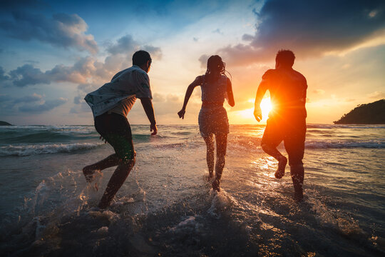 Friends playing on beach