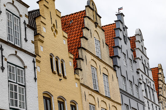 A row of historic gabled houses on the market square in Friedrichstadt, Schleswig-Holstein, Germany