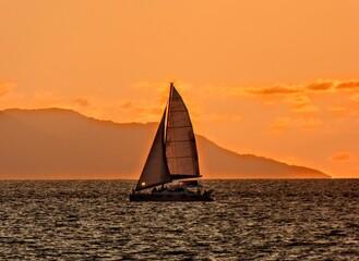 Fototapeta Sailboat Sailing On Sea Against Sky During Sunset obraz