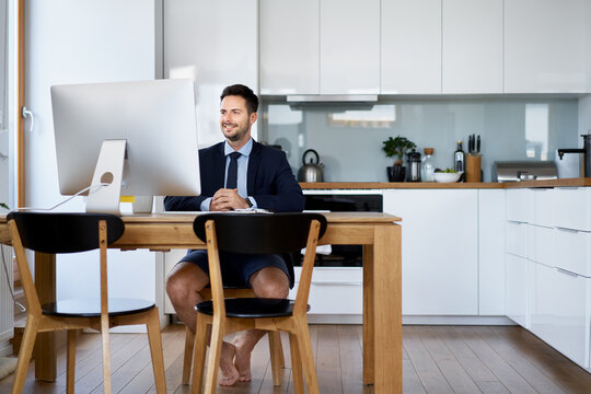 Businessman having video conference while working from home