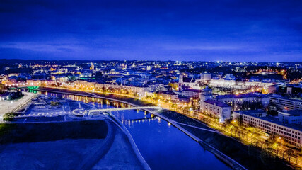 Fototapeta Aerial view of night panorama in Vilnius by drone