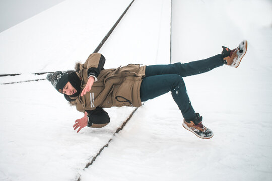 Man slipping on ice and falling down