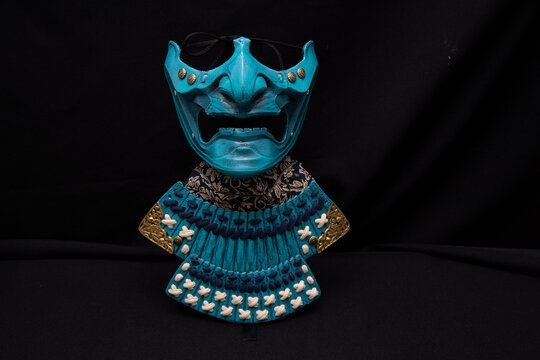 mempo samurai mask with a black background