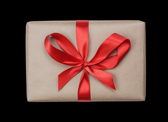 Wrapped celebragift box with red ribbon. Present box to a celebration isolated on a black background