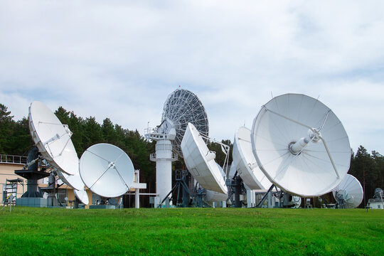 Base with satellite dishes. Satellite dishes looking into the sky. Lots of satellite dishes.