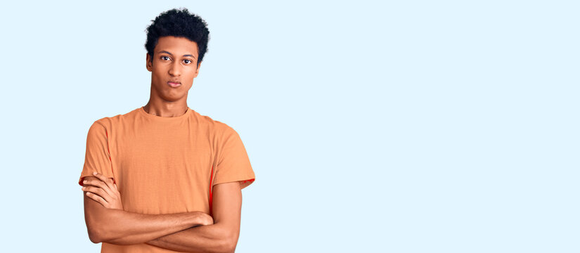 Young african american man wearing casual clothes skeptic and nervous, disapproving expression on face with crossed arms. negative person.