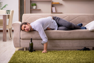 Young drunk man suffering at home
