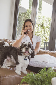 Brazilian woman working from home with her pet dog