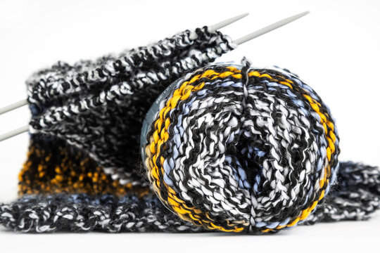Close-up on knitting needles and a wool ball