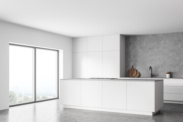 White and concrete kitchen corner with island and window