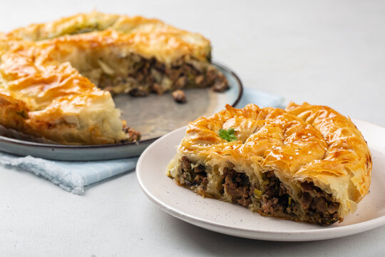 Rolled Burek - savoury pie fith meat and mushrooms feeling, decorated with sesam seedes. Peace of pie.
