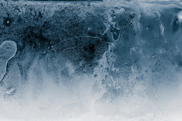 Obraz Ice texture background. Textured cold frosty surface of ice block on dark background. - fototapety do salonu